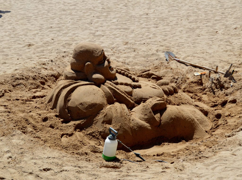 Buddha in the sand in Cannes