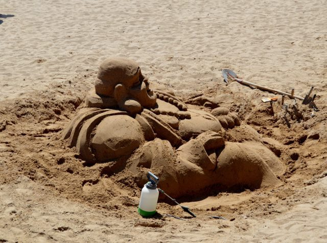 Happy Budda in the sand
